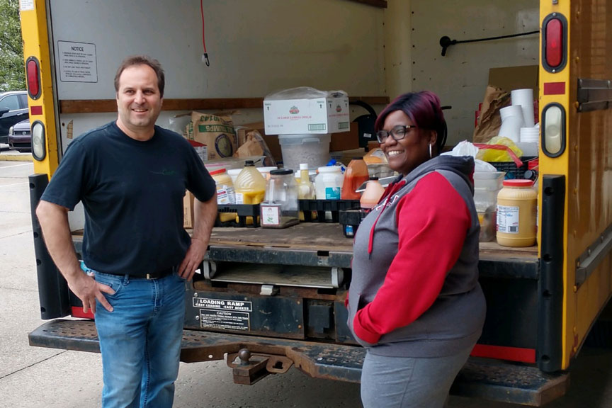 At MillCos Hospitality and Cosentino Restaurants, we feel it's important to give back to our community. In mid May, we donated $4,000 in perishable and non-perishable food items to Kent Social Services. Marquice Seward, Program Manager helped Dave Cosentino, Chef and Owner/Operator at MillCos Hospitality Group, LLC. with unloading the truck.